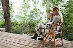 Young woman sitting on a porch Stock Photo - Premium Royalty-Free, Artist: Robert Harding Images, Code: 6114-06599742