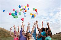 release - Young people releasing balloons Stock Photo - Premium Royalty-Freenull, Code: 6114-06599779