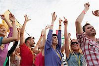 Young people cheering at festival Stock Photo - Premium Royalty-Freenull, Code: 6114-06599804