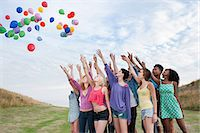 release - Young people releasing balloons Stock Photo - Premium Royalty-Freenull, Code: 6114-06599827