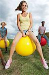 Young people bouncing on hoppity horses Stock Photo - Premium Royalty-Free, Artist: CulturaRM, Code: 6114-06599840