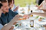 People at outdoor dinner party Stock Photo - Premium Royalty-Free, Artist: Blend Images, Code: 6114-06599846