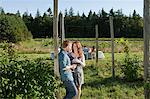 Young couple on farm with wine glasses Stock Photo - Premium Royalty-Free, Artist: Minden Pictures, Code: 6114-06599870