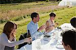 People at a dinner table in field Stock Photo - Premium Royalty-Freenull, Code: 6114-06599933