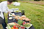 Chef preparing meal in a field Stock Photo - Premium Royalty-Free, Artist: Photocuisine, Code: 6114-06599940