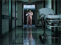 Nurse holding newborn baby in hospital corridor Stock Photo - Premium Royalty-Freenull, Code: 6114-06599981
