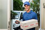 Delivery man delivering parcel Stock Photo - Premium Royalty-Free, Artist: Cultura RM, Code: 6114-06600167