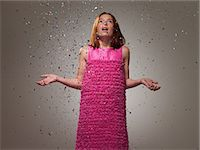 preteen open mouth - Young girl wearing pink dress with ticker tape, portrait Stock Photo - Premium Royalty-Freenull, Code: 6114-06600209