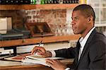 Restaurant owner looking at paperwork Stock Photo - Premium Royalty-Free, Artist: Blend Images, Code: 6114-06600365