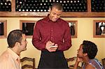 Waiter taking customer orders in restaurant Stock Photo - Premium Royalty-Free, Artist: Susan Findlay, Code: 6114-06600377