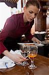 Waitress clearing table Stock Photo - Premium Royalty-Free, Artist: CulturaRM, Code: 6114-06600378