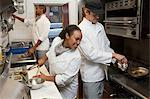 Chef working in commercial kitchen Stock Photo - Premium Royalty-Free, Artist: Laurie Rubin, Code: 6114-06600386