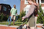 Couple with pushchair talking to neighbor Stock Photo - Premium Royalty-Freenull, Code: 6114-06600423