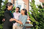 Mother with son and daughter outside home Stock Photo - Premium Royalty-Free, Artist: R. Ian Lloyd, Code: 6114-06600433