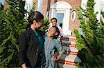 Mother with son and daughter outside home Stock Photo - Premium Royalty-Free, Artist: Alberto Biscaro, Code: 6114-06600448