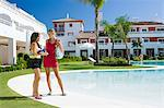 Two female friends by poolside on vacation Stock Photo - Premium Royalty-Free, Artist: Robert Harding Images, Code: 6114-06600586