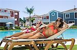 Two women sunbathing on sunloungers at poolside Stock Photo - Premium Royalty-Free, Artist: Cultura RM, Code: 6114-06600598
