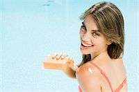 Woman applying suncream Stock Photo - Premium Royalty-Freenull, Code: 6114-06600611