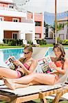 Two women sunbathing on sunloungers reading magazines Stock Photo - Premium Royalty-Free, Artist: Robert Harding Images, Code: 6114-06600625