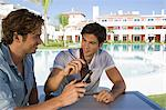Two male friends enjoying beer on holiday Stock Photo - Premium Royalty-Free, Artist: CulturaRM, Code: 6114-06600628