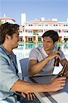Two male friends enjoying beer on holiday Stock Photo - Premium Royalty-Free, Artist: AWL Images, Code: 6114-06600629