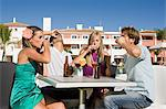 Four friends drinking shots on holiday Stock Photo - Premium Royalty-Free, Artist: Cultura RM, Code: 6114-06600638