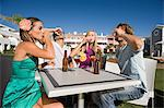 Four friends drinking shots on holiday Stock Photo - Premium Royalty-Free, Artist: Blend Images, Code: 6114-06600640
