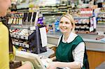 Female cashier and customer at supermarket checkout Stock Photo - Premium Royalty-Free, Artist: Blend Images, Code: 6114-06600658