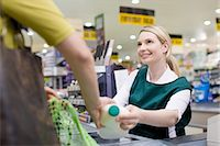 Female cashier and customer at supermarket checkout Stock Photo - Premium Royalty-Freenull, Code: 6114-06600660