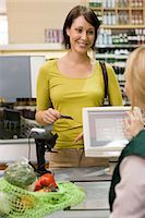 Woman at supermarket checkout Stock Photo - Premium Royalty-Freenull, Code: 6114-06600662