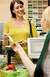 Cashier handing receipt to customer Stock Photo - Premium Royalty-Free, Artist: Blend Images, Code: 6114-06600664