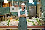 Portrait of a fishmonger Stock Photo - Premium Royalty-Free, Artist: Westend61, Code: 6114-06600670
