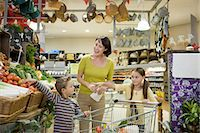 Mother and children in supermarket Stock Photo - Premium Royalty-Freenull, Code: 6114-06600682