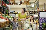 Mother and children in supermarket Stock Photo - Premium Royalty-Freenull, Code: 6114-066
