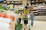 Mother and children in supermarket Stock Photo - Premium Royalty-Freenull, Code: 6114-06600688