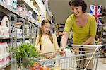 Mother and daughter getting milk in supermarket Stock Photo - Premium Royalty-Freenull, Code: 6114-06600691