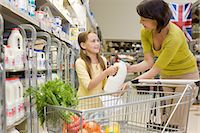 Mother and daughter getting milk in supermarket Stock Photo - Premium Royalty-Freenull, Code: 6114-06600692