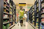 Woman shopping in supermarket Stock Photo - Premium Royalty-Free, Artist: Blend Images, Code: 6114-06600700