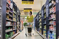 Woman shopping in supermarket Stock Photo - Premium Royalty-Freenull, Code: 6114-06600701