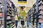 Mother and children in supermarket Stock Photo - Premium Royalty-Freenull, Code: 6114-06600703
