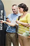 Couple choosing sauce in supermarket Stock Photo - Premium Royalty-Free, Artist: Blend Images, Code: 6114-06600722
