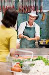 Fishmonger and customer Stock Photo - Premium Royalty-Free, Artist: Blend Images, Code: 6114-06600724