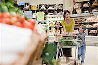 Mother and children in supermarket Stock Photo - Premium Royalty-Freenull, Code: 6114-06600726