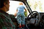 Father and young son in a car Stock Photo - Premium Royalty-Free, Artist: Siephoto, Code: 6114-06600750
