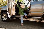 Boy in cowboy hat, climbing into station wagon Stock Photo - Premium Royalty-Free, Artist: Robert Harding Images, Code: 6114-06600752