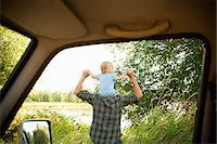 Father with son on shoulders, viewed from a car Stock Photo - Premium Royalty-Freenull, Code: 6114-06600768