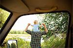 Father with son on shoulders, viewed from a car Stock Photo - Premium Royalty-Free, Artist: CulturaRM, Code: 6114-06600768
