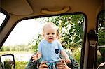 Boy being held by car window Stock Photo - Premium Royalty-Free, Artist: Boone Rodriguez, Code: 6114-06600769