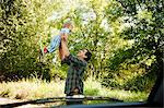 Father lifting up baby son Stock Photo - Premium Royalty-Free, Artist: Ty Milford, Code: 6114-06600770