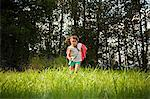 Girl running in field wearing a cape Stock Photo - Premium Royalty-Free, Artist: AWL Images, Code: 6114-06600773
